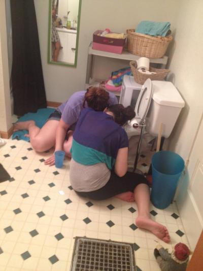 College students puking in toilet