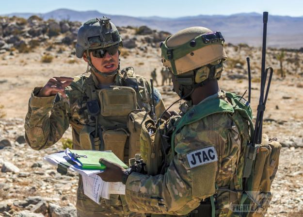 Two Air Force JTACs discuss mission parameters prior to calling in CAS