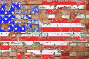 chipped flag on brick wall
