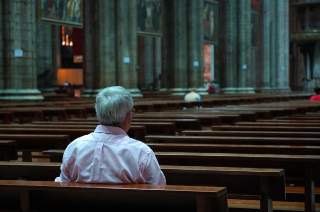 man-in-church-alone