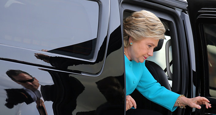 U.S. Democratic presidential candidate Hillary Clinton arrives to boards her campaign plane at Miami international airport in Miami, Florida, U.S., October 26, 2016