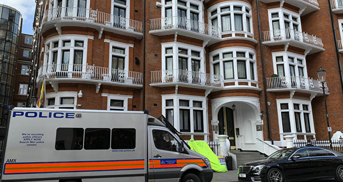 A police van parked outside the Ecuadorian Embassy in London, after WikiLeaks founder Julian Assange was arrested by officers from the Metropolitan Police and taken into custody Thursday April 11, 2019