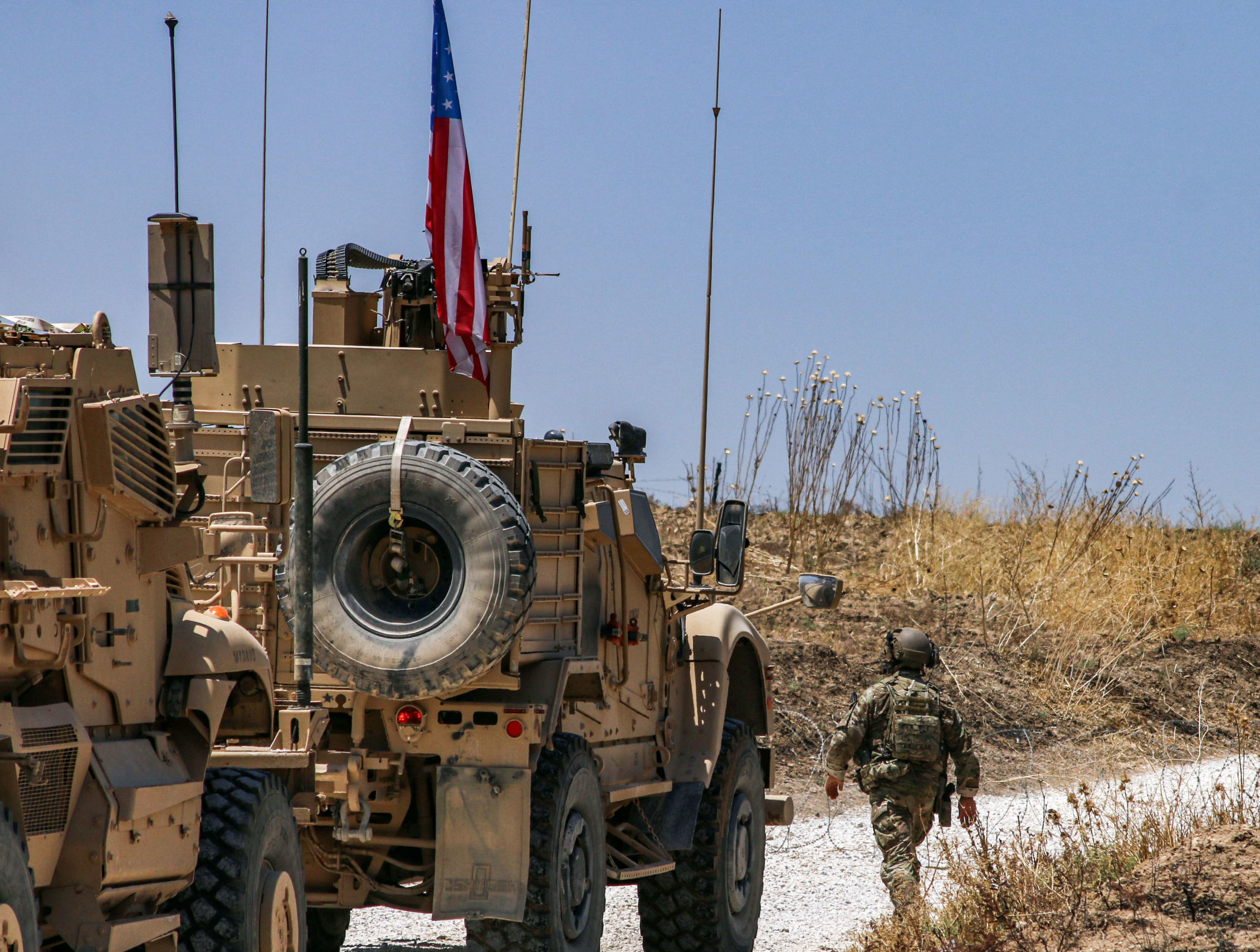 Armoured vehicles of the US-led coalition patrol the city of Ras al-Ain in Syria's Hasakeh province on July 28, 2019.