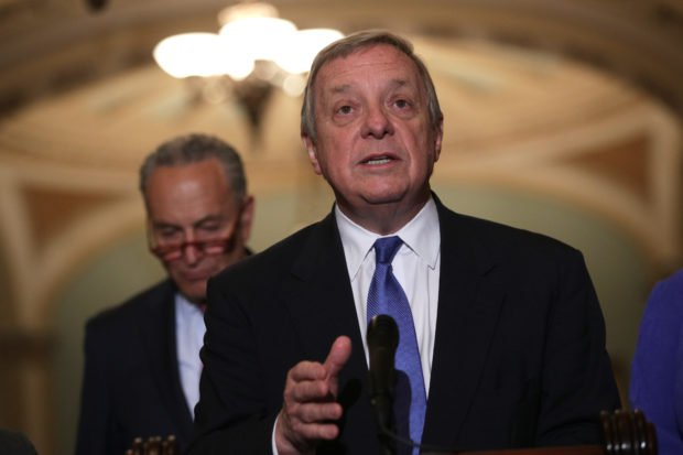 WASHINGTON, DC - JUNE 11: U.S. Senate Minority Whip Richard Durbin (D-IL) (R) speaks as Minority Leader Chuck Schumer (D-NY) (L) listens during a news briefing after the weekly Senate Democratic policy luncheon June 11, 2019 at the U.S. Capitol in Washington, DC. Schumer used the opportunity to criticize the lack of legislative movement under Republican control. (Photo by Alex Wong/Getty Images)