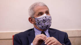 Keep that mask on: Fauci says face coverings could be needed even in 2022, as he defines new 'normality'