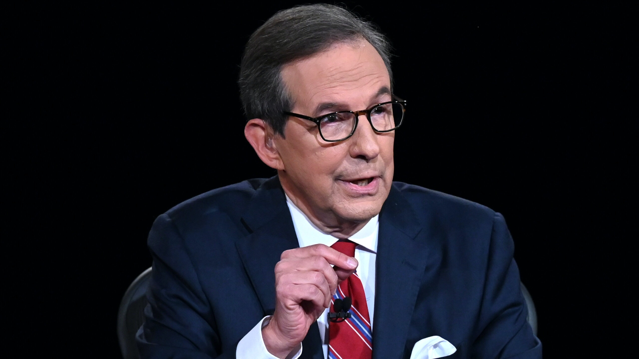 Debate moderator and Fox News anchor Chris Wallace directs the first presidential debate at Case Western Reserve University and Cleveland Clinic in Cleveland, Ohio, on September 29, 2020.