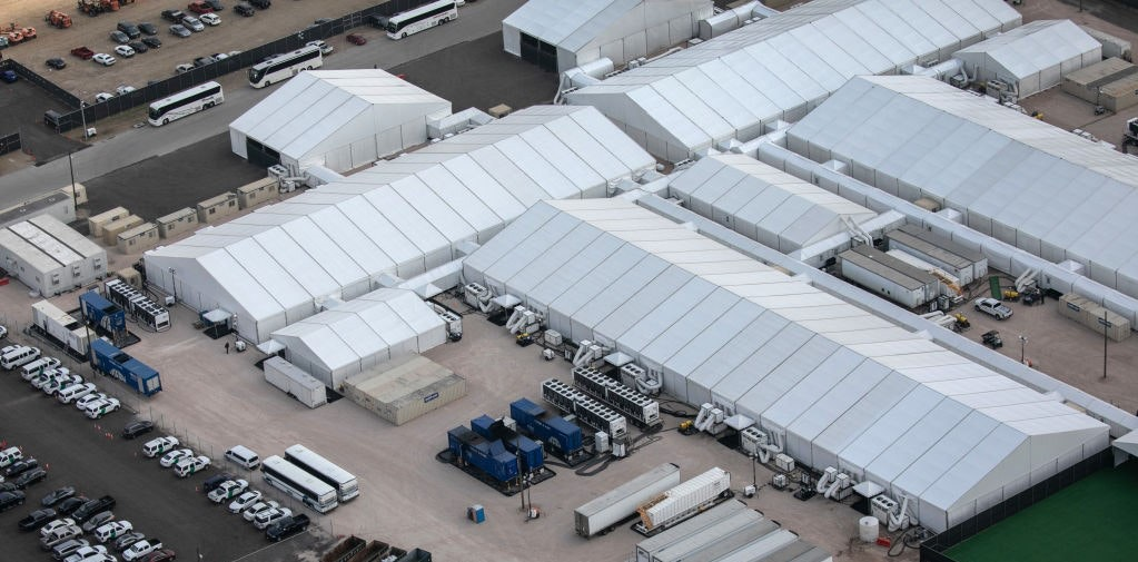 DONNA, TEXAS - MARCH 23: A temporary Customs and Border Protection processing center is seen from a Texas Department of Public Safety helicopter on March 23, 2021 in Donna, Texas. A surge of immigrants, including unaccompanied minors crossing into the United States from Mexico is overcrowding such centers in south Texas. (Photo by