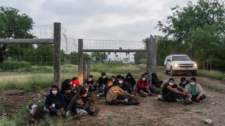 Central American migrants near the Rio Grande River in La Joya, Texas, are shown after being apprehended by US Border Patrol officers in June.