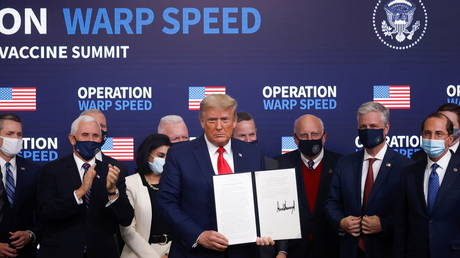 Donald Trump signs an executive order on vaccine distribution during an Operation Warp Speed Vaccine Summit at the White House in Washington, US, December 8, 2020.